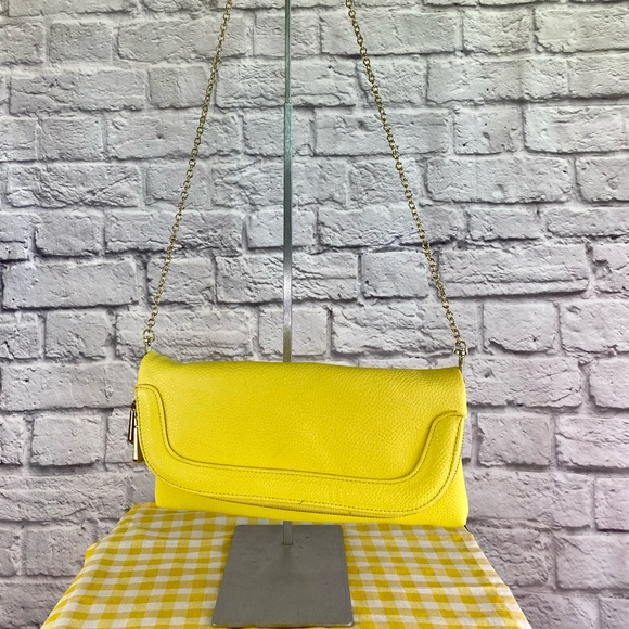 Charming Charlie yellow Shoulder clutch purse
